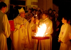 EASTER VIGIL Ñ Bishop Albert LeGatt lights the Easter Candle from the new fire blessed at Easter Vigil April 7 at St. Paul's Cathedral in Saskatoon.