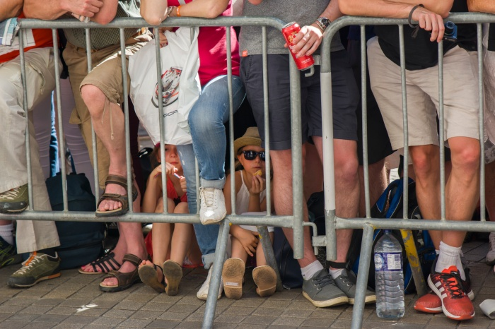 LE MANS, FRANCE - JUNE 16, 2017: A crowd of people and children behind the barrier at a Parade of pilots